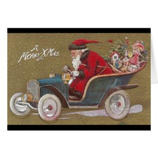 Cartão Papai Noel que conduz o Roadster azul