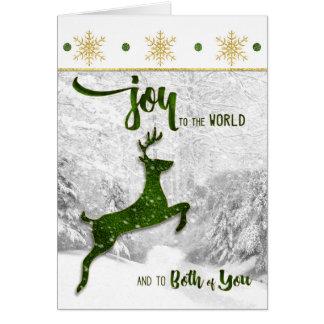 Cartão para a alegria do Natal do casal aos cervos do