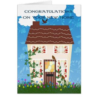 Cartão Parabéns Home novos com uma casa e as flores