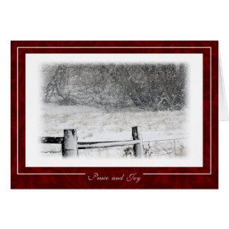 Cartão Paz do Natal e cena nevado do inverno da alegria