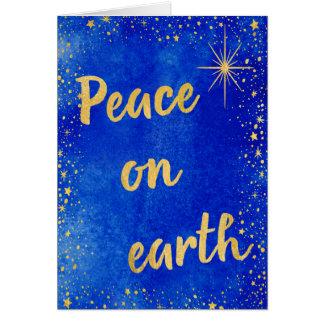 Cartão Paz no azul e no ouro do Natal da terra