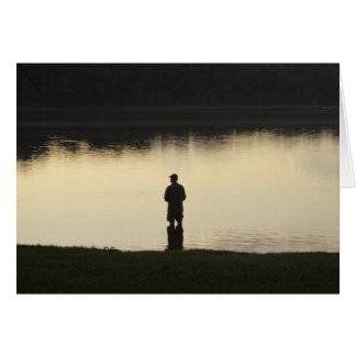 Cartão pescador do por do sol