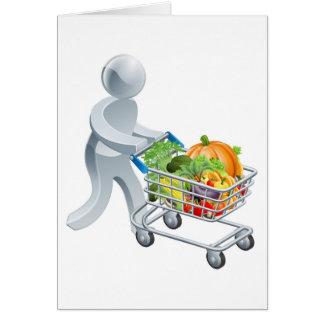 Cartão Pessoa que empurra o trole com vegetais