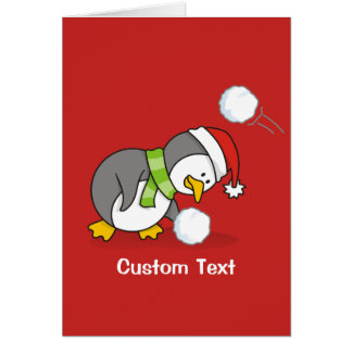 Cartão Pinguim do Natal que obtem uma bola da neve