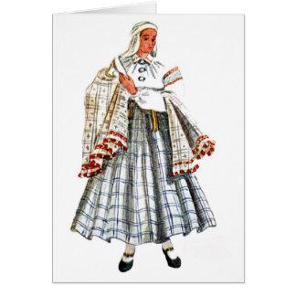 Cartão popular tradicional letão do traje
