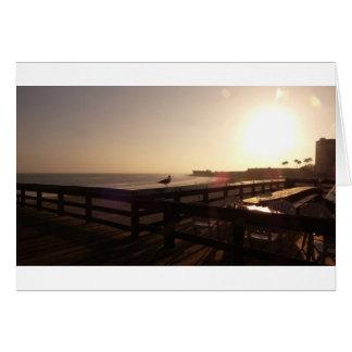 Cartão Por do sol no cais