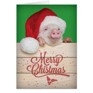 Cartão Porco leitão bonito do Natal do pudim no chapéu do