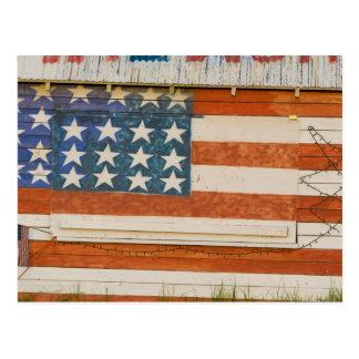Cartão Postal A bandeira americana pintada em fogos-de-artifício