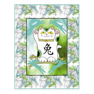 Cartão Postal Ano do coelho Neko no azul da piscina dos oásis