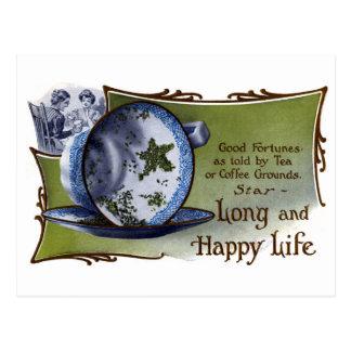 Cartão Postal As folhas de chá dadas forma estrela prevêem a boa