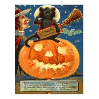 Cartão Postal Bastão da bruxa do gato preto da lanterna de Jack