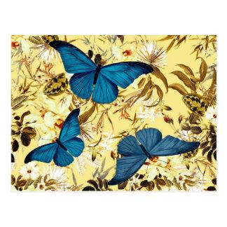 Cartão Postal Borboletas azuis no teste padrão floral do creme