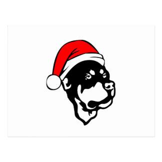 Cartão Postal Cão de Rottweiler que veste o chapéu vermelho do