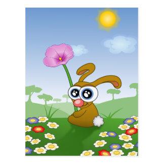 Cartão Postal Coelho engraçado que senta-se na grama
