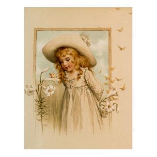 Cartão Postal Flores de cheiro da menina no chapéu de palha