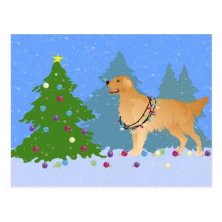 Cartão Postal Golden retriever que decora a árvore de Natal