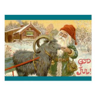 Cartão Postal Jultomten alimenta a cabra de Yule um biscoito