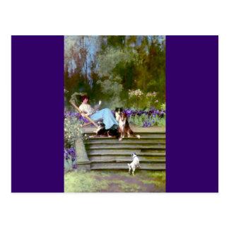 Cartão Postal Leitura da mulher com cães do collie