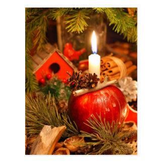 Cartão Postal Luz de vela sob o pinheiro
