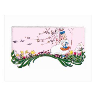 Cartão Postal Menina no monte de florescência no primavera