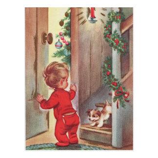Cartão Postal Natal da criança e do filhote de cachorro do