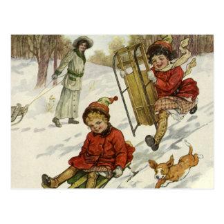 Cartão Postal Natal vintage, crianças do Victorian que Sledding