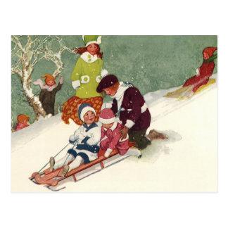 Cartão Postal Natal vintage, crianças que Sledding na neve