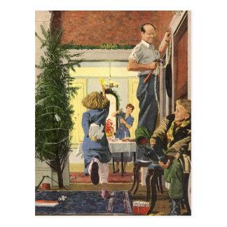 Cartão Postal Natal vintage, família que decora a casa