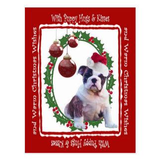 Cartão Postal O filhote de cachorro do Natal do buldogue abraça