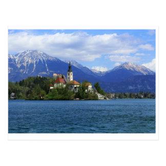 Cartão Postal O lago sangrou a ilha - o tesouro de Slovenia