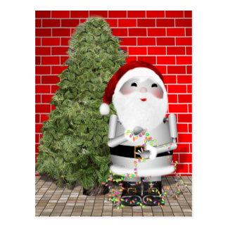 Cartão Postal O papai noel pequeno Robo-x9 decora sua árvore de