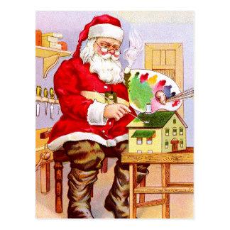 Cartão Postal Papai Noel que pinta uma casa de boneca