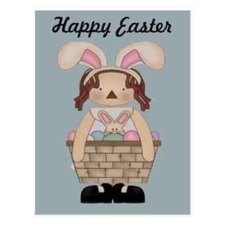 Cartão Postal Páscoa Annie com um cheio da cesta dos ovos