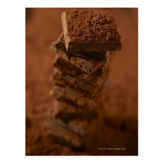 Cartão Postal Pilha dos quadrados do chocolate
