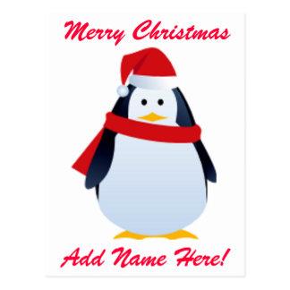 Cartão Postal Pinguim do Natal em um chapéu do papai noel
