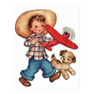 Cartão Postal Plano e filhote de cachorro modelo do menino