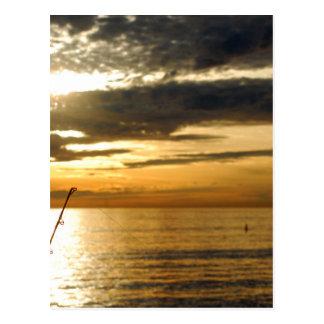 Cartão Postal por do sol pacífico dourado