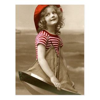Cartão Postal Red Hat e veleiro
