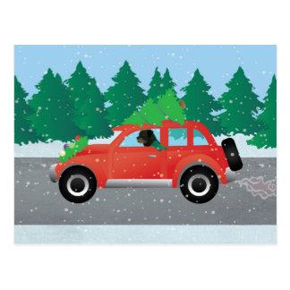 Cartão Postal Rottweiler que conduz o carro do Natal