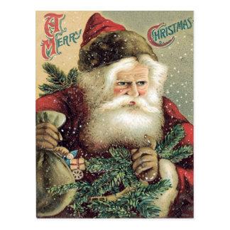 Cartão Postal Saco de Papai Noel de ramo do Evergreen dos