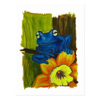 Cartão Postal Sapo azul que relaxa no ramo da flor e de árvore