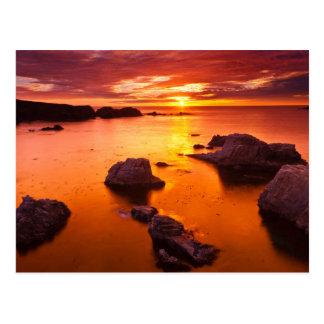 Cartão Postal Seascape alaranjado, por do sol, Califórnia