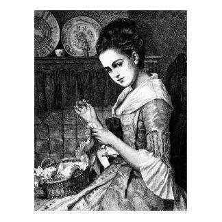 Cartão Postal Sewing da mulher