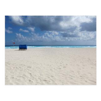 Cartão Postal Uma cadeira de praia espera