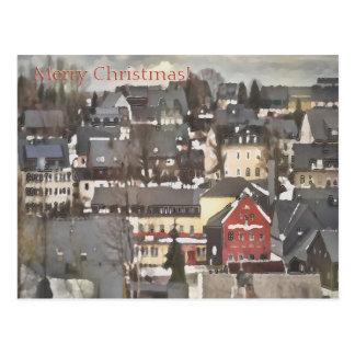 Cartão Postal Vila do inverno com Feliz Natal vermelho de uma