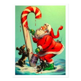 Cartão Postal Vintage Papai Noel que pinta um bastão de doces