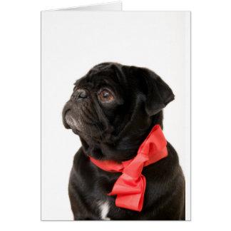 Cartão Pug preto com arco vermelho