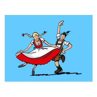 Cartão que dança o casal bávaro de Oktoberfest