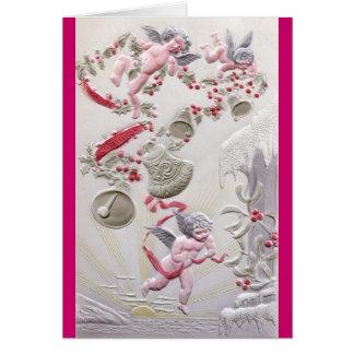 Cartão Querubins sobre o oceano com azevinho e festão de