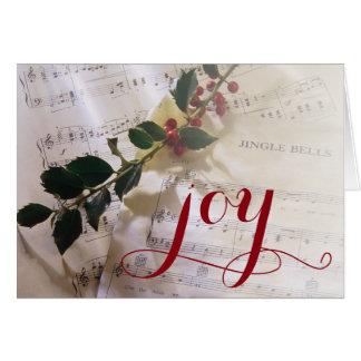 Cartão Ramo do azevinho sobre a partitura para o Natal